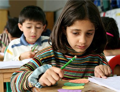 Pakistan Girl Student Doing Classwork